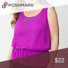 22/24W Lane Bryant Sequined Peplum Tank Top Peplum tank top from Lane Bryant in a size 22/24W. Size equivalent is a 3X. Chiffon fabric with a sequin embellished neckline. Elastic at the waist. A button closure at the back of the neck. New with tags. Lane Bryant Tops Tank Tops