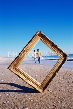 Royalty-Free Images: Couple Seen Through Picture Frame On Beach