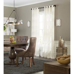 Foxton is a semi-sheer, light filtering panel featuring neutral colors that are easy to decorate with. Woven horizontal wide bands alternate between solid faux linen and metallic shimmery stripes. Grommets make it simple to layer with other panels or stand alone. #diningroom #curtains #lowes