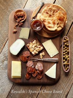 The perfect Spanish cheese board with Drunken Goat, Monte Enebro, Manchego, Cinco Lanzas and Iberico ham.