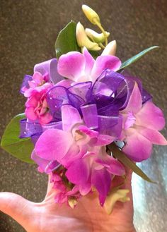 Orchid corsage made entirely using oasis floral adhesive....attach bow to wristlet...then glue flowers and green sprigs directly into the bow....holds strong..and stays intact and fresh actually BETTER than a wired corsage and so much easier!