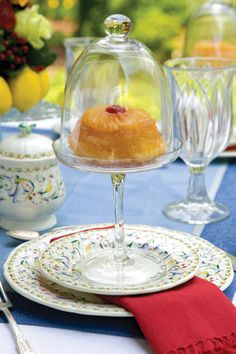 Use pretty domed petite cake pedestals to keep desserts fresh at an outdoor tea.