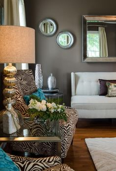 The Most Popular Benjamin Moore Earth Toned Paint Colours : Accent / Feature Walls - Kylie M Interiors.  Shown in this living room is Whitall Brown by Benjamin Moore with funky zebra striped chairs and metallic accent pieces. #ZebraStripe #EcclecticStyle