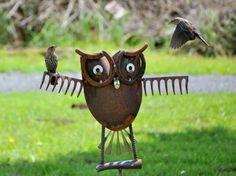 Just too cute!  Owl yard art made from old rake,  horseshoe - welding skills needed.