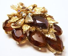 Mid Century amber glass rhinestone brooch •Signed Art, a better quality costume jewelry company •Brown amber rhinestone and small faux pearls