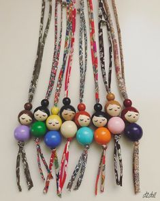 Handpainted Wooden Beaded Dolls ~ Liberty London and Lecien Fabric Chains - Handpainted . - Hand-Painted Wooden Bead Dolls ~ Liberty London and Lecien Fabric Chains – Hand-Painted Wooden Be - Wooden Bead Necklaces, Wooden Jewelry, Wooden Beads, Beaded Jewelry, Handmade Jewelry, Beaded Bracelets, Doll Crafts, Bead Crafts, Jewelry Crafts