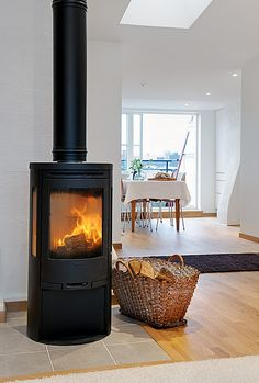 A contemporary small apartment with Swedish style Interior Design. A small space apartment, with very cozy and spacious interior. Home Living Room, Living Spaces, Old Stove, Sweet Home, Wood Burner, Modern Fireplace, Herd, Scandinavian Style, Family Room