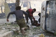HE'S HIT: Free Syrian Army fighters rushed to help their fellow fighter after he was shot by a sniper loyal to Syria's President Bashar al-A...