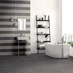 PIETRA DEL FRIULI is a compact tile with a textured surface for stone effect floor and wall tiling with long-lasting beauty.  Tile in photo - Coem Ceramiche Pietra del Friuli_DARK GREY+LIGHT GREY. For more product info please log on to our website www.arabuild.ae