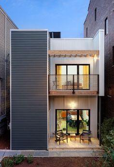 Fachada de casa pequena de dois pavimentos