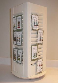 Here is the tutorial I wrote for Jewelry Making Journal on how to make a rotating jewelry display from shutters!