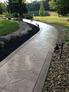 Log homes landscaping front entrance pictures front - Stamped concrete walkway ideas ...