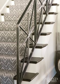 A graphic runner by Stark Carpets complements a custom iron stair rail. A graphic runner by Stark Carpets complements a custom iron stair rail. Wrought Iron Stair Railing, Metal Stairs, Staircase Railings, Staircase Design, Stairways, Banisters, Staircase Runner, Spiral Staircases, Painted Stairs