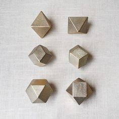 Polyhedron Brass Paper Weights A collaboration between designer Oji Masanori and old Japanese foundry Futagami. Platonic Solid, Tabletop Accessories, Men's Accessories, Paper Weights, Dungeons And Dragons, Form, Decoration, Stationery, Design Inspiration