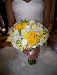 This is a bridal bouquet of hydrangea, roses, ranunculas, stock, freesia and tulips