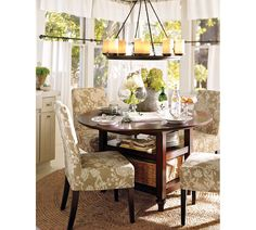 Pottery barn cafe curtains, parsons chairs, round table.  **Wouldn't this be cute in the corner of a Family Room as a game/homework table?!?