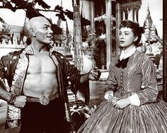 "Yul Brynner and Deborah Kerr in The King and I. The King has come up with something that interests him and he wants to know what Anna thinks of it. Anna looks at him and in her mind she says, ""Uh huh."""