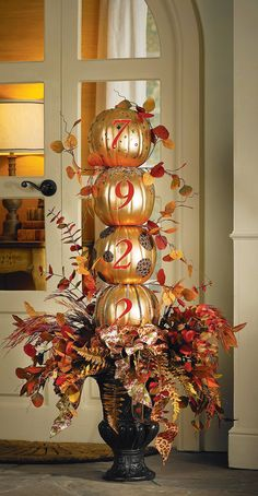 Decorated metallic gold pumpkins with animal print ribbon, fall leaves and fern
