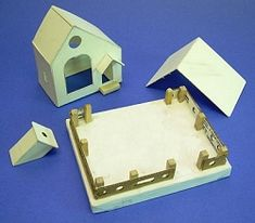 downloadable pdf instructions and templates to make a cardboard putz house with a picture window. Great for an adult to build and a kid to decorate!