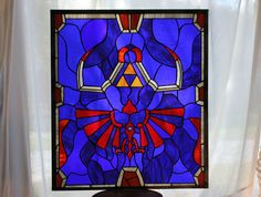 Stained glass Legend of Zelda! (Legend of Zelda - Link's Hylian Shield X Stained Glass Panel by Martian Glass Works)