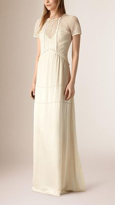 A silk crepe satin floor-length dress from Burberry, featuring a floral lace bodice