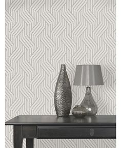 Stylish Pembrey Geometric Silver Wallpaper features a timeless geometric pattern with contrasting finishes for added depth and luxury. Free UK delivery available
