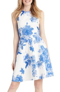 Loving the gorgeous floral print blooms that adorn this fit-and-flare dress from Donna Morgan. So perfect for spring!