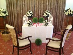 civil ceremony setup including rose trees bouquets lanterns petals and greenery by rkd floral displays