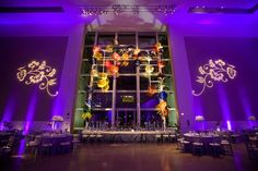 Wedding at Dallas Museum of Art in Dallas. BEYOND provided purple uplighting and gobos to create the perfect ambiance lighting! www.beyondld.com