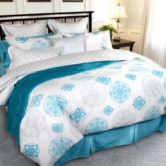 Keeva Collection: The reverse of the duvet is an intricate Celtic knot pattern in the coordinating celadon green.