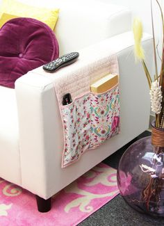 Weekend DIY: Sew Your Own Remote Control Caddy. I started sewing my own once and didn't finish it. One day I will!
