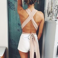 LF nude wrap bodysuit nwt Brand new LF bodysuit! Perfect for going out! New with tags, decided I just don't need it LF Tops