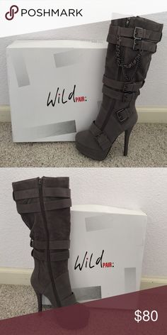 "Brand New WILD PAIR Gray LUCIA Platform Boots Brand New WILD PAIR Gray LUCIA Platform Boots in size 6 in original box. Faux suede platform boots, gun-metal buckles and chain embellishments with 5"" heel, 1.5"" platform and 14.5"" shaft height. Wild Pair Shoes Heeled Boots"