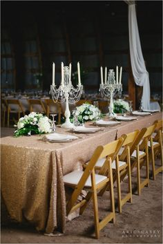 glamorous head table for barn wedding with gold glitter and blush accents