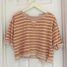 Lush crop sweater top Orange and white cropped sweater top. Super cute and comfortable! Lush Sweaters