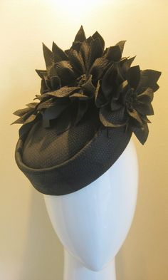 A beautiful blocked pillbox in dark brown bonded leather snakeskin, fully lined with a beautiful floral print. Set off with five matching abstract flowers. Fashion and Designer Style Millinery Hats, Pillbox Hat, Fascinator Hats, Fascinators, Headpieces, Victorian Hats, Leather Hats, Cocktail Hat, Fancy Hats