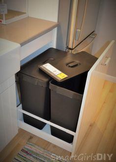 American sized garbage cans pullout of IKEA SEKTION base cabinet, with lids!