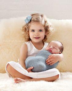 Cute big sister, cute lil baby.
