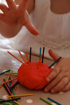 The benefits of playing with play dough - poking objects into and pulling them out strengthens hand muscles and coordination