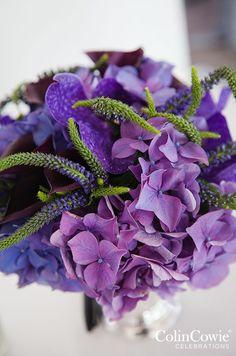 Purple Flower Inspiration: Accented by greenery, purple hydrangeas look modern and elegant. http://www.colincowieweddings.com/flowers-and-decor/purple-wedding-flowers