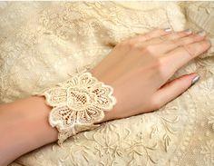 Make one!!  (lace bracelet cuff ROSA vintage ecru by tinaevarenee on Etsy, $27.00)