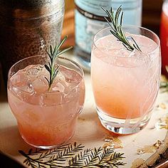 Rosemary-Grapefruit Gin Cocktail Pretty in pink, yes, but this sweet drink has bite, too, thanks to grapefruit's subtle bitterness and the woodsy notes of gin and rosemary. This recipe makes enough rosemary-infused syrup for several cocktails. Best Gin Cocktails, Gin Cocktail Recipes, Vodka Cocktails, Refreshing Cocktails, Cocktail Drinks, Yummy Drinks, Summer Cocktails, Sweet Cocktails, Party Drinks