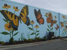 Chip Wilkinson's Butterfly Mural on the wall of Portlock Galleries in South Norfolk