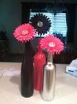 These spray-painted wine bottles made gorgeous centerpieces for Rachel & Josiah's wedding reception!