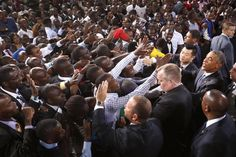 The crowd surges toward President Obama as he greets the audience after his remarks at an indoor stadium in Nairobi July 26, 2015