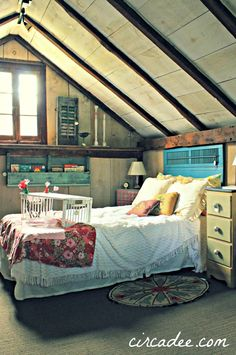 Love attic rooms like this! Especially the exposed beams
