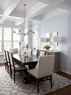 Gorgeous Dining Room love the vaulted ceilings and area rug and mixture of chairs!!