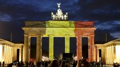 The Brandenburg gate illuminated in black, yellow and red Credit: Reuters