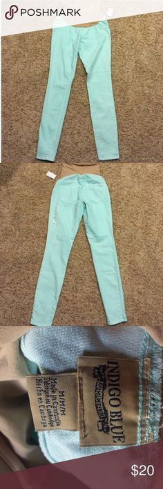 Motherhood Maternity Mint Jeans by Indigo Blue Super adorable light teal/mint colored skinny jeans purchased from Motherhood Maternity. Brand is indigo blue. Very stretchy throughout and very comfortable with a high maternity band to cover belly. Size M would fit (my guess) 6 or 8 comfortably since it has stretch. Used but great condition! Motherhood Maternity Jeans Skinny