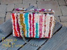 Rags & Silk Purse--Locker hooked on 3.3 mesh canvas with recycled sari silk & osnaburg fabric. Lined with silk.